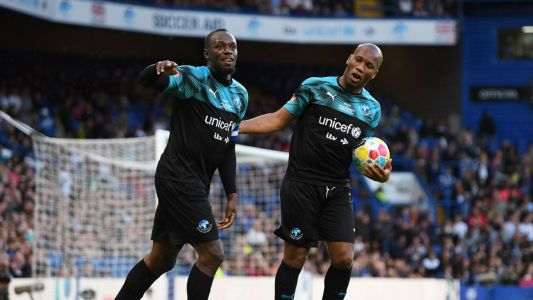Bolt shames Carragher with goal in charity game