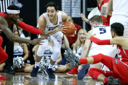 Aggies' second-half rally holds off New Mexico, 91-83