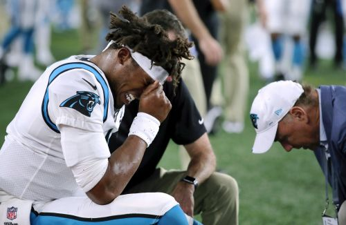 Panthers' Cam Newton remains in walking boot, gets treatment