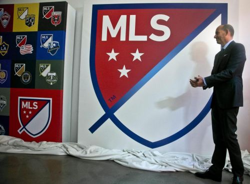 MLS cutting pay of top executives and some staff, source says