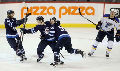 Trouba scores in OT to lift Jets over Blues 5-4