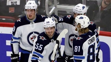 Red-hot Jets get past Blackhawks in OT
