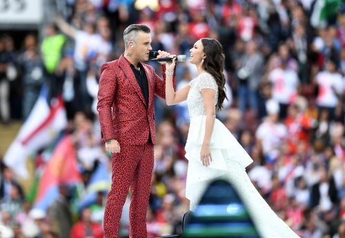 Fox apologizes for Robbie Williams' flippant finger at World Cup opener