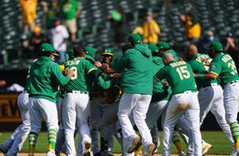 Athletics win 11th straight in wild walk-off 13-12 win in extra innings over Twins