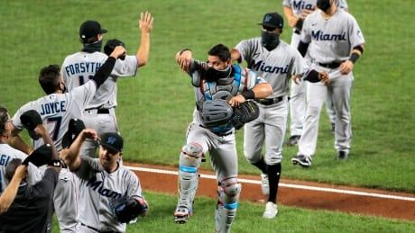 Miami Marlins resume season with 18 new players and a win