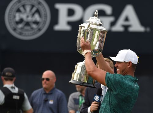 Brooks Koepka outpoints Tiger Woods in heavyweight PGA Championship battle for the ages