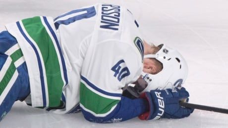 Canucks rookie Elias Pettersson 'day-to-day,' may play Wednesday