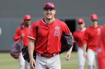 Trout plays full game a day after receiving record contract