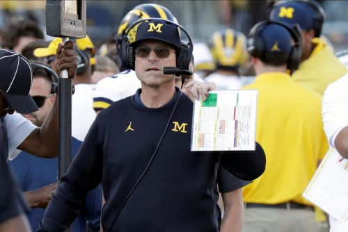 Harbaugh's new-look staff at Michigan adds coach Ron Bellamy