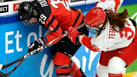 Captain Marie-Philip Poulin reinjures knee in Canada's win at hockey worlds