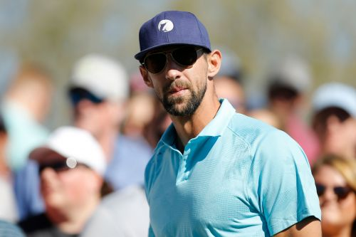 Michael Phelps discusses viral Masters moment behind Tiger Woods