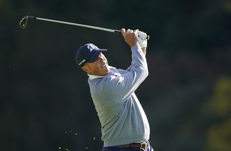 Woods 5 back of Kuchar's lead after opening-round 69 at Riviera