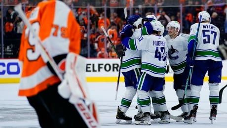 Canucks thwart late comeback to outlast Flyers in shootout for 1st win of season
