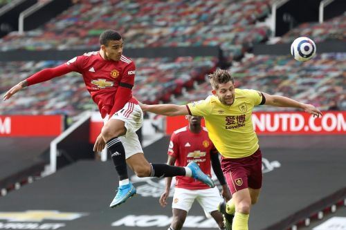 Man United beats Burnley 3-1, closes gap on City to 8 points