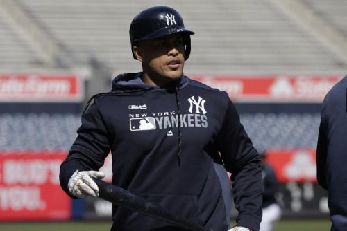 New York Yankees' Giancarlo Stanton could miss start of season