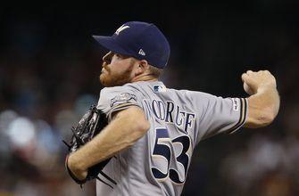Brewers' Woodruff leaves in 4th inning against Diamondbacks
