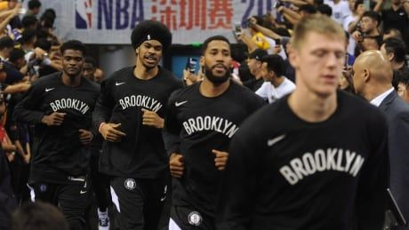 Back from China, Nets learn from LeBron and steer clear of controversy