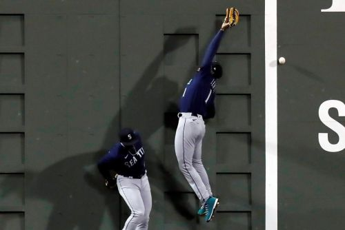 Mariners rally with 4-run 10th, beat Red Sox 7-3 on 3 hits