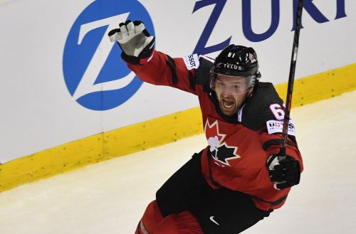 Canada rallies to beat Switzerland in overtime in world hockey quarterfinal