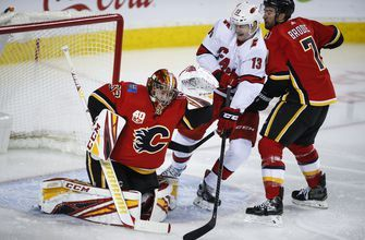 Canes end Flames' 7-game win streak; Isles top Sabres in OT