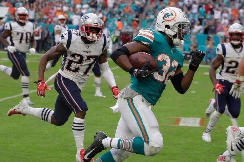 Dolphins stun Patriots on miracle last-second circus play