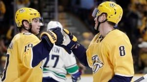 Canucks' rally falls short as Preds escape with OT victory
