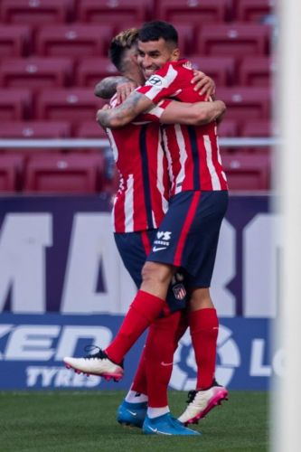 Atlético routs Eibar 5-0 to stay ahead in Spanish league
