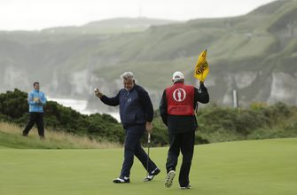 The Latest: Nothing honorary about Clarke's play at Portrush
