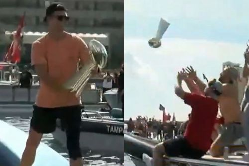 Tom Brady throws Lombardi Trophy to another boat during Super Bowl parade
