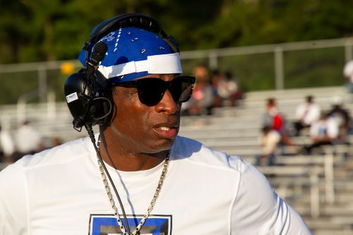 How Deion Sanders helped secure a pardon from Donald Trump for rapper Lil Wayne