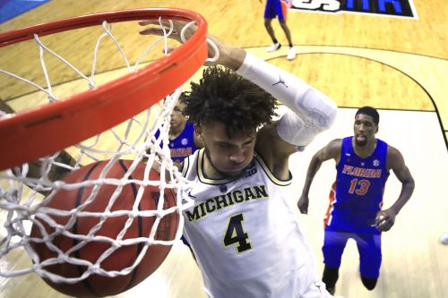 Michigan beats Florida at its own game to storm into Sweet 16