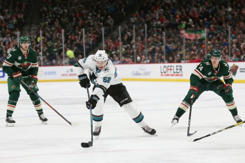 Jones shuts out Wild, Couture scores twice in Sharks 4-0 win