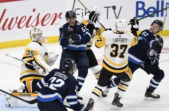 Jarry makes 27 saves, Penguins rout Jets 7-2