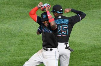 Corey Dickerson, Jesus Aguilar both homer, Marlins take down Cubs in Game 1 of Wild Card series
