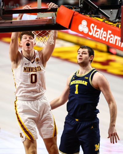 No. 19 Minnesota hands No. 5 Michigan its first loss of season in a rout