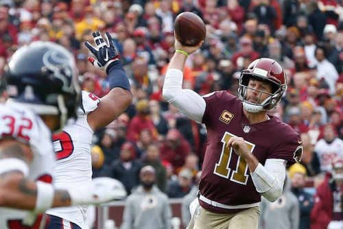 Alex Smith carted off from Redskins' game vs. Texans with leg injury