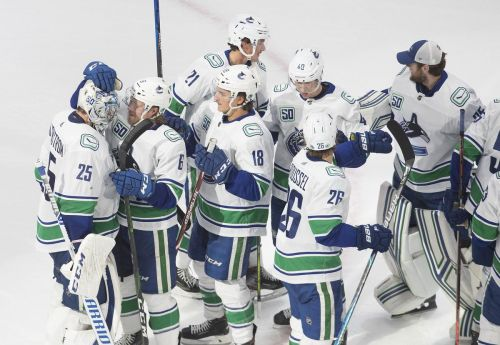 Canucks beat Wild, take series lead in penalty-filled NHL qualifying game