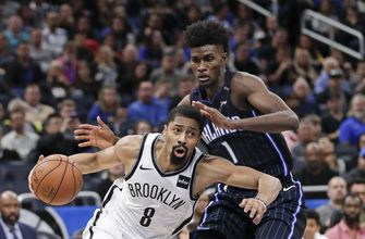 Russell scores 40 points, Nets rally to beat Magic