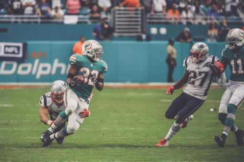 Watch: Dolphins' Kenyan Drake scores miracle TD to upset Patriots