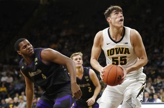 Cook scores 18, No. 23 Iowa beats Western Carolina 78-60