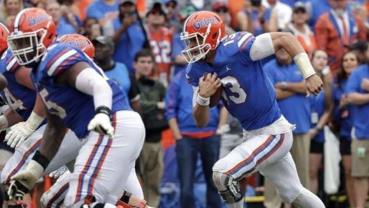 College football: Feleipe Franks rallies No. 15 Florida to beat South Carolina; Oklahoma escapes rival; Alabama and Michigan roll