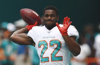 Dolphins release Walton after arrest for hitting girlfriend