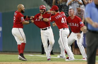 Rangers rally to top Angels 8-7 in 11 innings