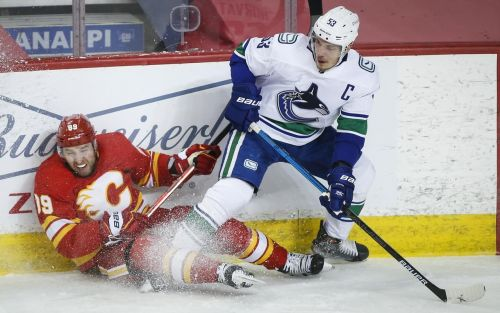Flames, Canucks keep playing for nothing amid NHL playoff launch