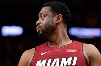 Dwyane Wade gives sign-holding Heat fan his shoe after game, which leads to uncontrollable tears