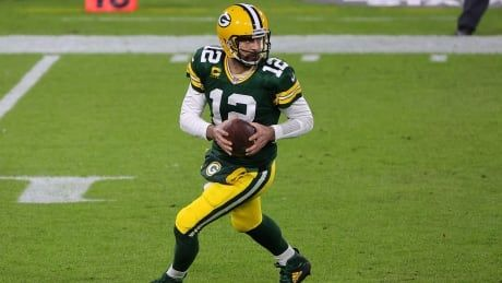 Aaron Rodgers in Green Bay for Packers training camp after missing team activities