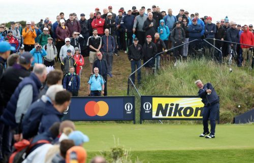 The Latest: Changing weather, steady Clarke at British Open