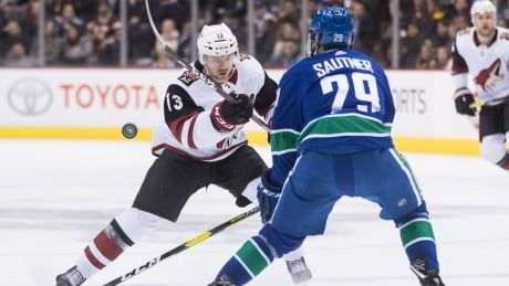 Coyotes erupt in 3rd period to put away Canucks in OT