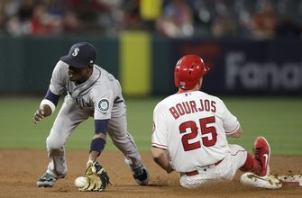 Mariners blow 8-run lead, rally for 11-10 win over Angels