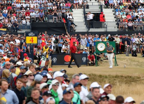 The Latest: Woods on prowl at the British Open